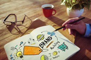 businessman writing brand identity